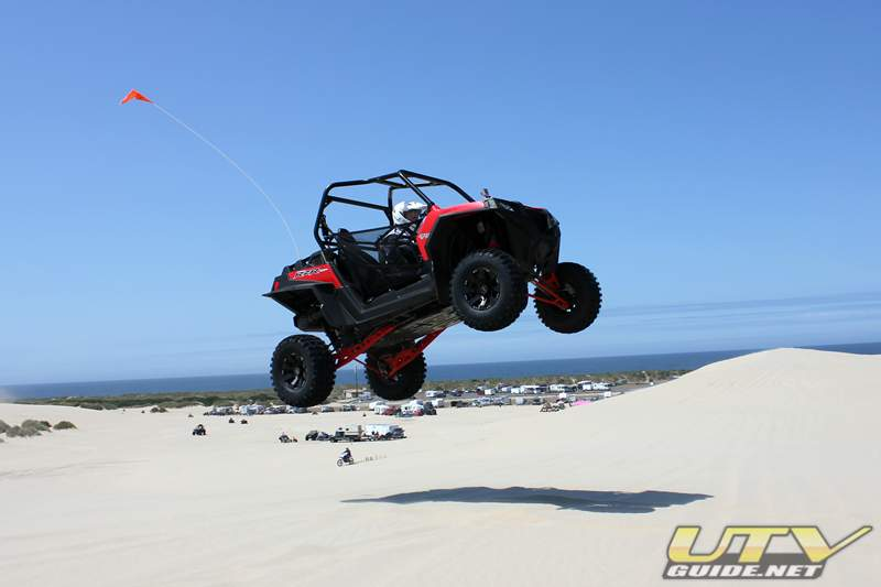 Polaris RZR XP jumping in the dunes