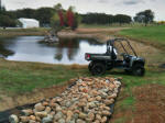 Rock Lined Pond Outlet - John Deere Gator