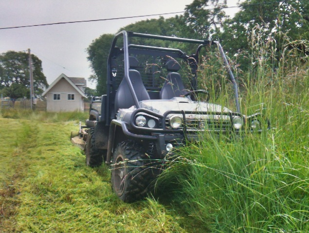 Kunz Engineering Rough Cut Field Mower behind John Deere Gator