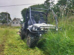 John Deere Gator XUV 825i with towable field mower