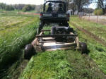 Rough Cut Field Mower behind a John Deere Gator XUV