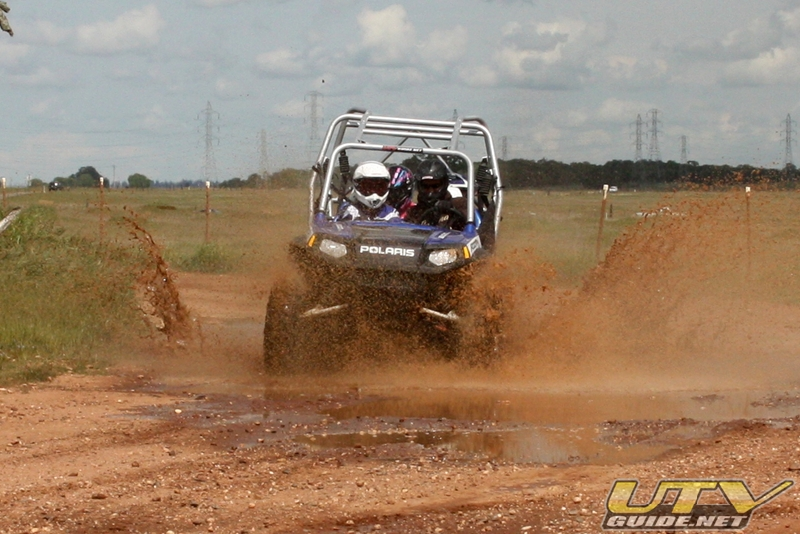 Polaris RZR 4 in the mud