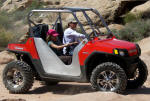 RZR with roll cage and side panel from DragonFire Racing