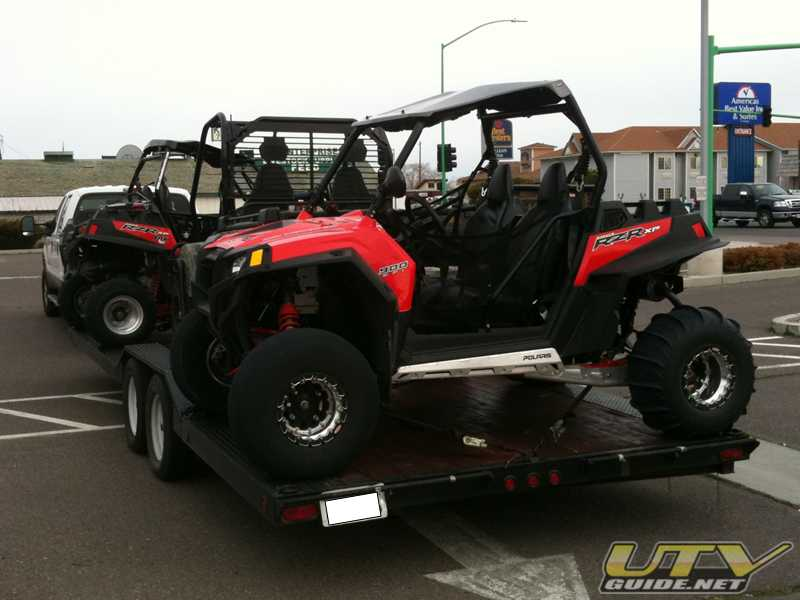 UTVs loaded on the trailer for home