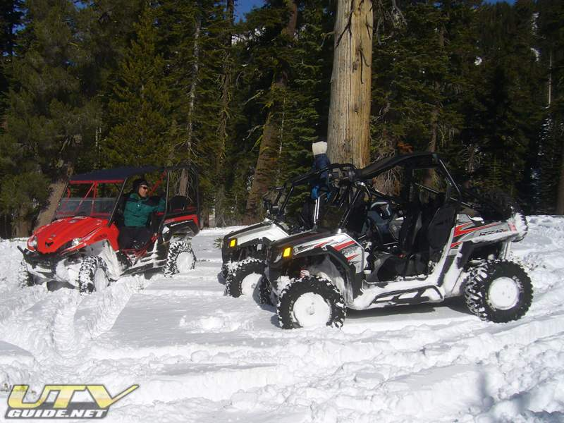 Kawasaki Teryx and two Polaris RZR S in the Sierra Snow