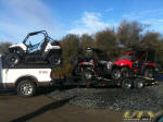 Polaris RZR S on the truck rack and two more on the trailer