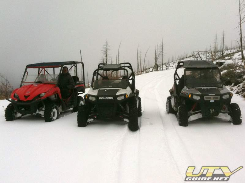 Kawasaki Teryx and two Polaris RZR S in the snow